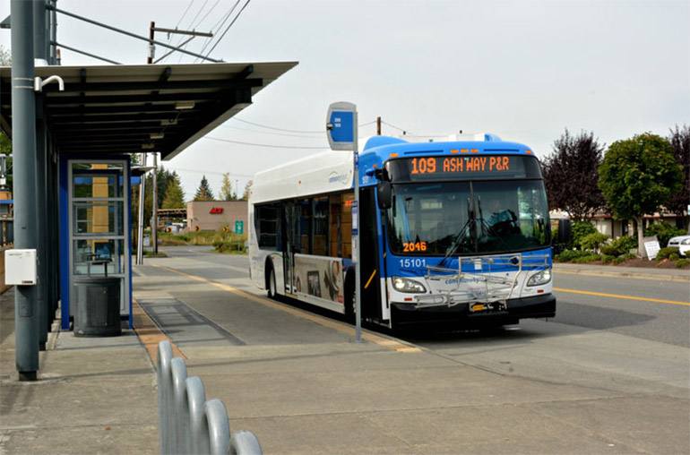 A Community Transit bus waits at a bus stop.