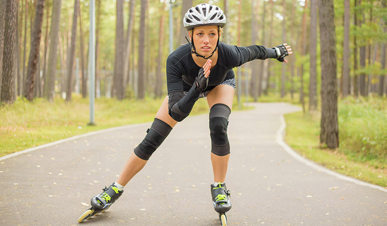 A person rollerblades on a path.